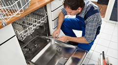 Man repairing open dishwasher